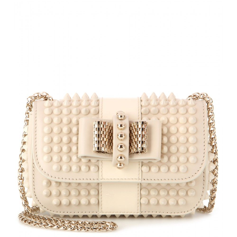 Christian Louboutin - Sweety Charity studded leather shoulder bag - This timeless cream leather 'Sweety Charity' shoulder bag packs serious punch. Tonal spiked studs are a tough embellishment, softened by the bow detail at the front.