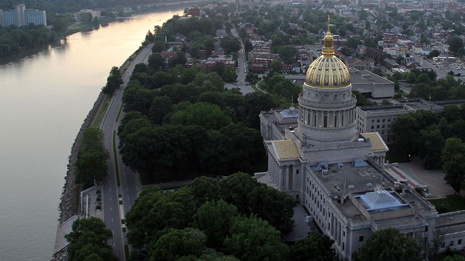 """Aerial America:West Virginia. It's where the Appalachian, Blue Ridge, and Allegheny Mountains converge, and where a fiercely independent spirit, forged during the Civil War, still lives today. From a legendary resort that hid a top-secret bunker to a futuristic facility exploring the mysteries of the universe, to thrill-seekers riding the Class-5 rapids and climbing its famous bluffs, this flight across the state's towering peaks reveals why John Denver called it """"almost heaven."""""""