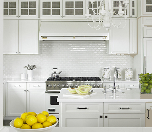 Traditional kitchen idea in New York with white backsplash, subway tile  backsplash and white cabinets
