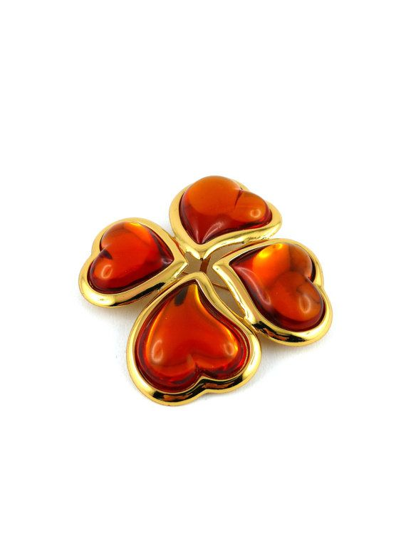 aabe996262a Gorgeous vintage brooch/pendant YVES SAINT LAURENT featuring a massive gold  tone and orange resin lucky four leaf clover. Marked