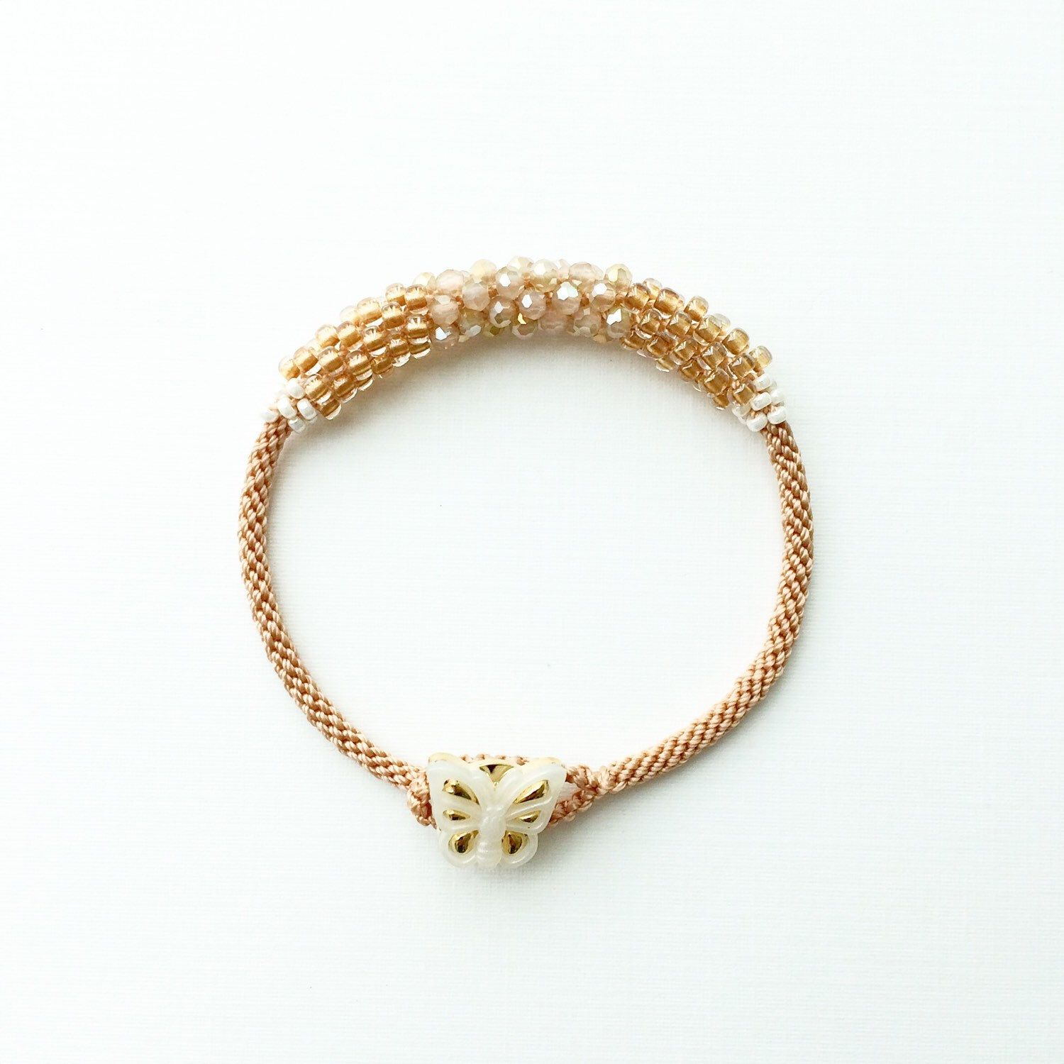 Nude Kumihimo Bracelet with Butterfly Button  by PetitKnot on Etsy https://www.etsy.com/listing/220572114/nude-kumihimo-bracelet-with-butterfly