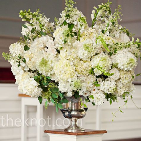 Large urns of hydrangeas snapdragons and greenery were for Center arrangements for weddings