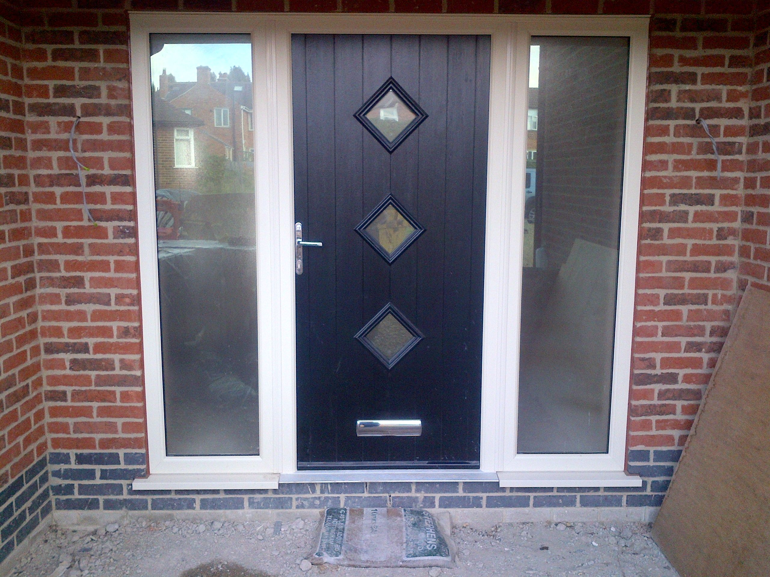 Contemporary Composite Door with cream UPVC side panels & frosted ...