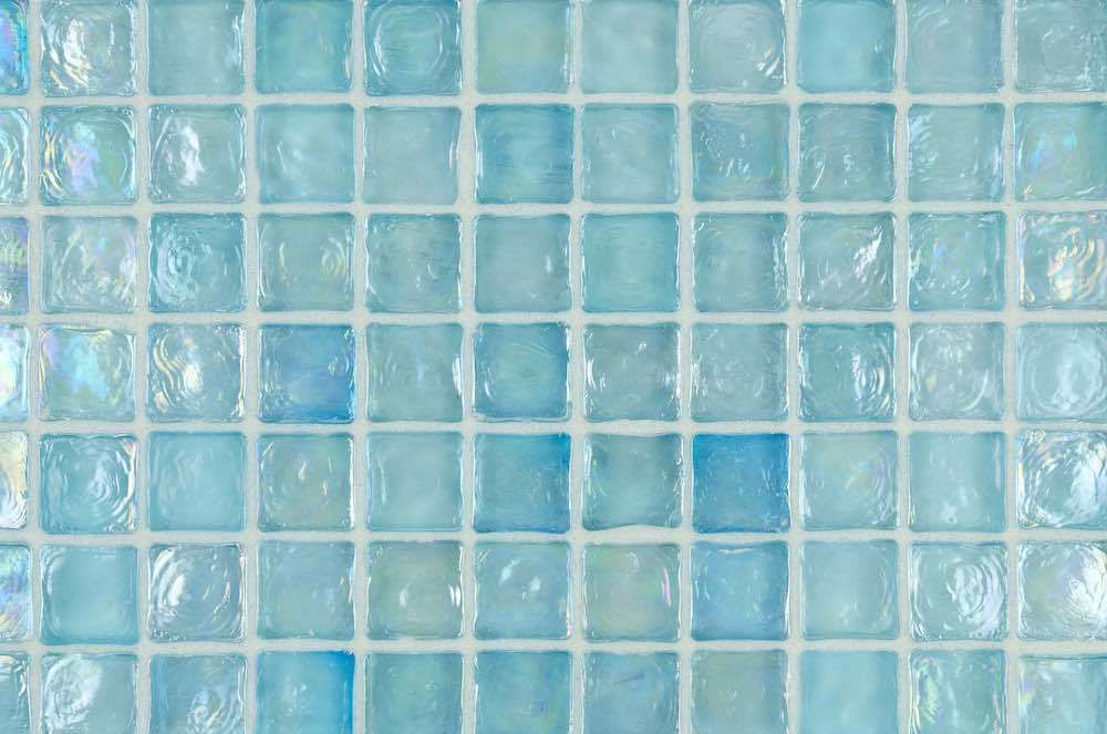Iridescent Glass Mosaic Tile In A Seafom And Aqua Blue Color Installed With Translucent Grout By Mineral Tiles Glass Mosaic Tiles Glass Tile Aqua Tiles