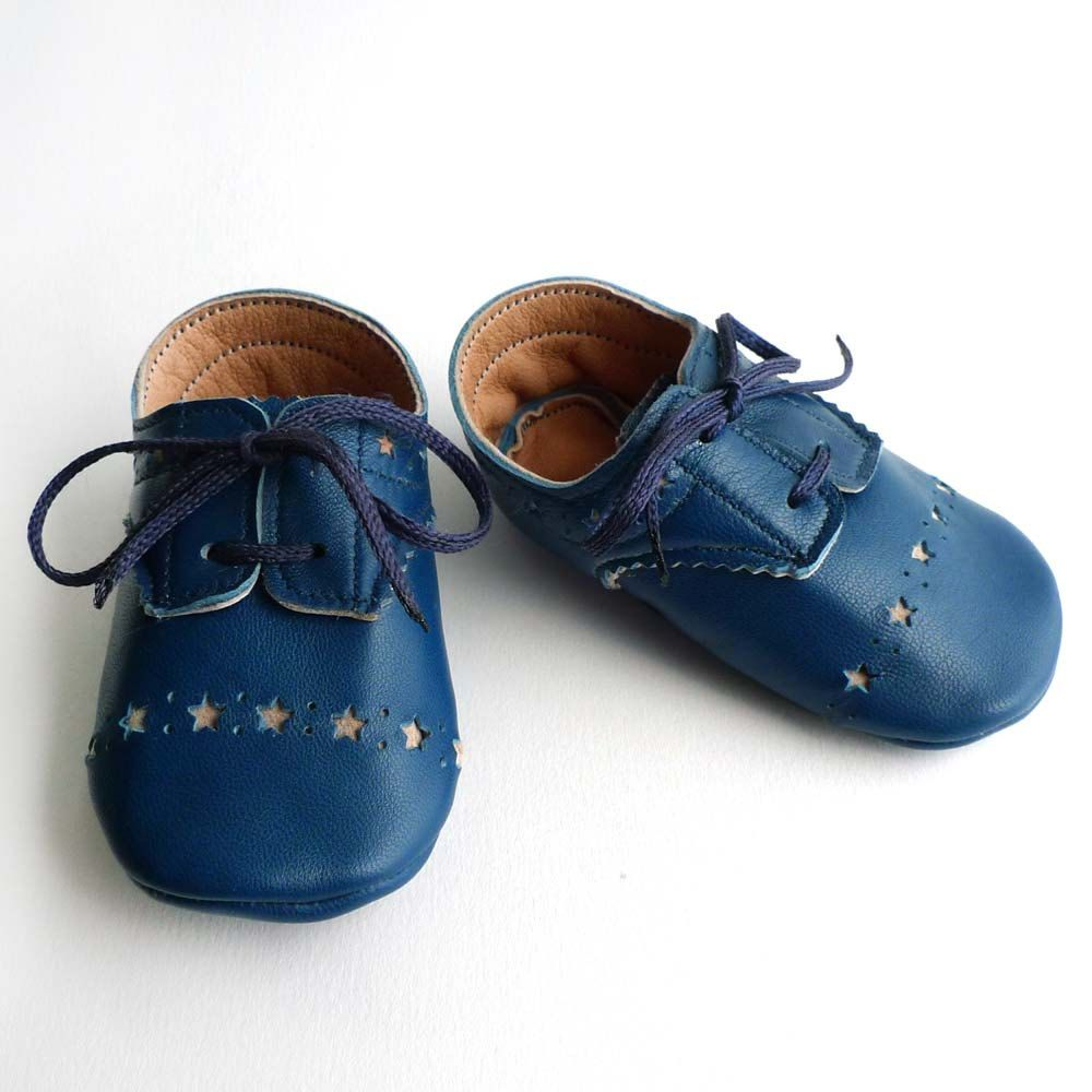 Adorable shoes for tiny feet decorated with tiny cut out stars.