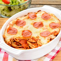 Baked Cavatini is a hearty pasta dish filled with three types of pasta, tomato meat sauce, pepperoni, and topped with cheese and more pepperoni.