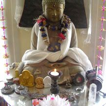 buddhist altar with statue of Buddha Shakyamuni and lotus