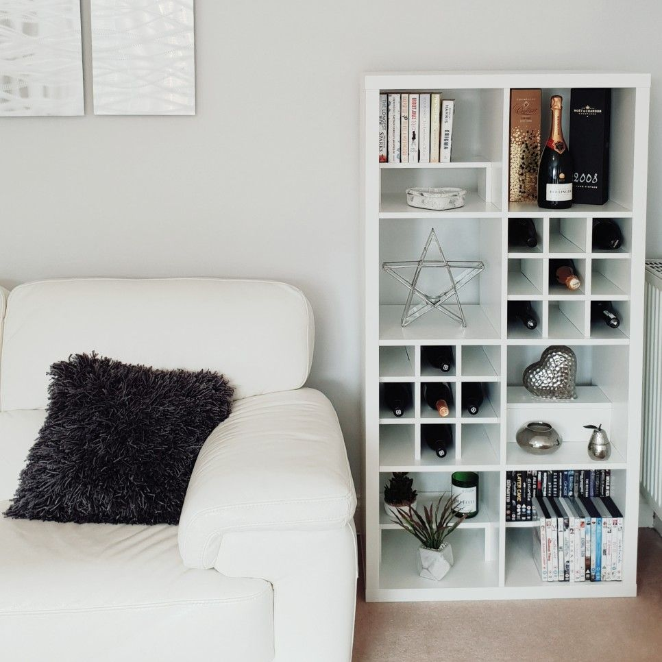 Living room storage using Ikea Kallax and inserts from Etsy