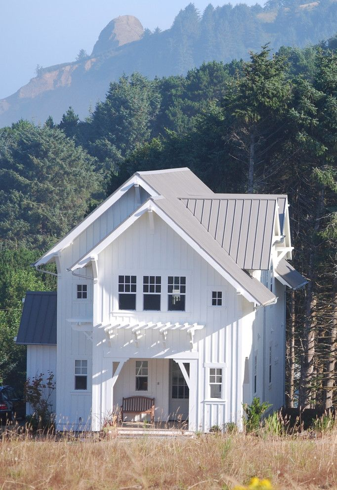 White house brown roof exterior farmhouse with standing for Tin roof house designs