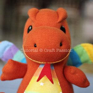 Free pattern & tutorial to sew sock dragon with 2 pairs of socks. This sock dragon has small arms, big foot, a pair of bat wings & a spiky back. - Page 2 of 2
