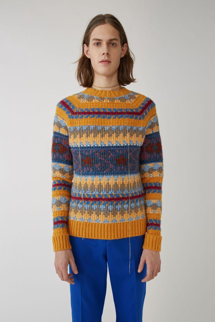 fb8db2b679ca Acne Studios yellow orange slim fit crewneck sweater in a multicoloured,  striped jacquard.