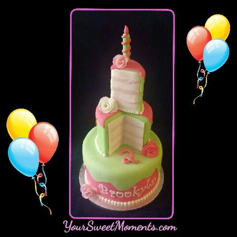 Fun carved pink and green first birthday cake