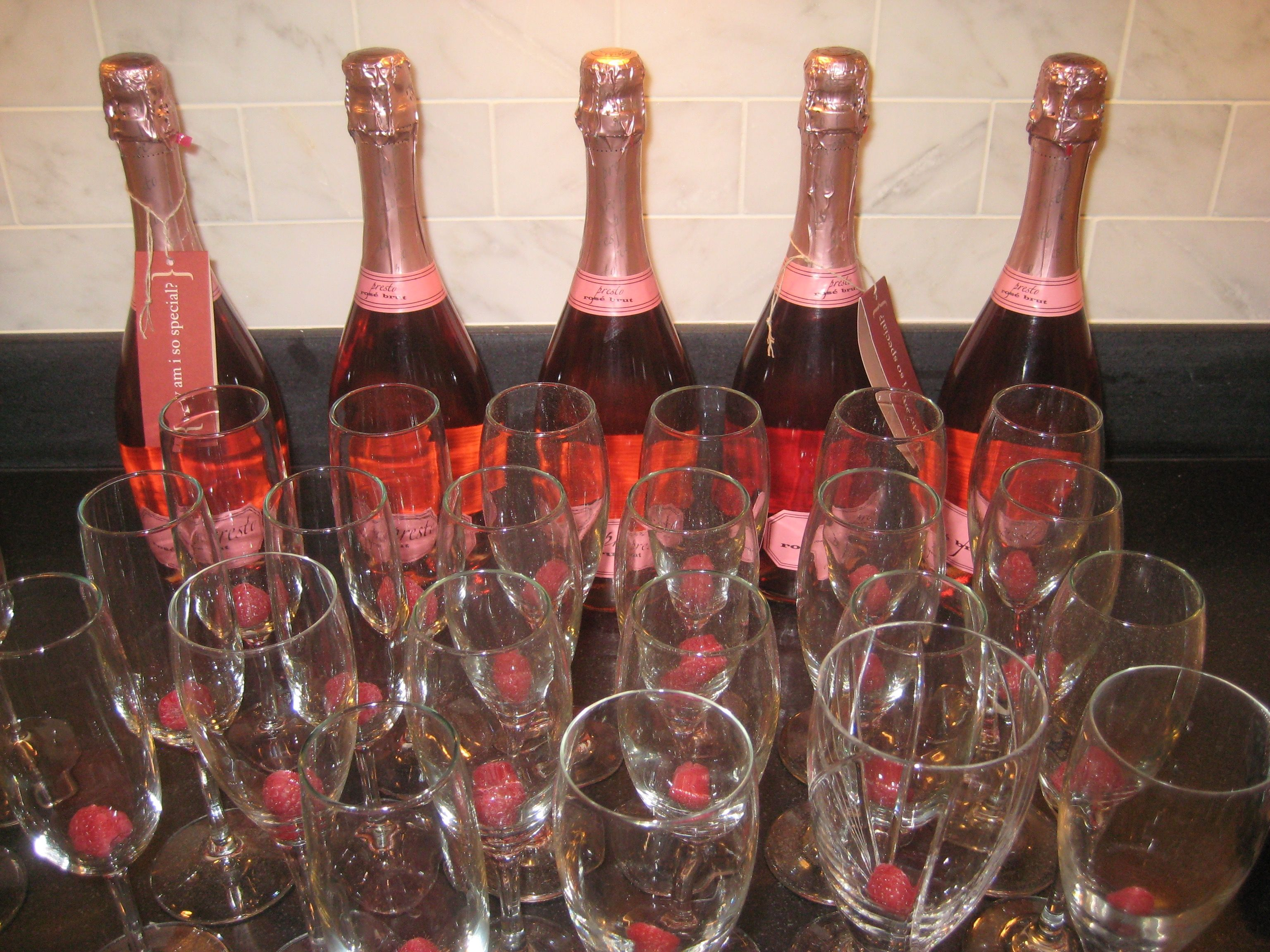 Cheers To Our Bubbly Champagne Set Up Put A Raspberry At The Bottom Of Each Glass For Decorative Detail Wine Bottle Elegant Entertaining Alcoholic Drinks