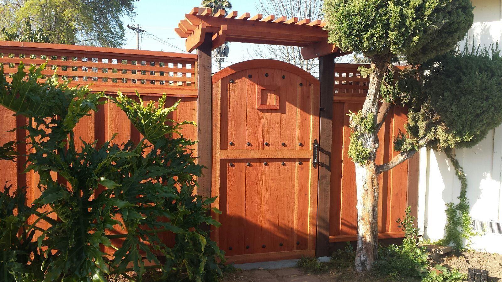 Custom redwood gate ammfencing backyard front yard