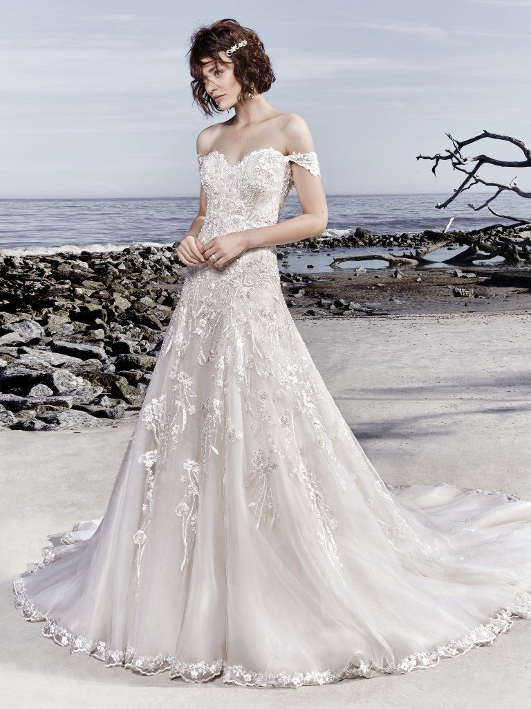 Laramie Unique Beaded Lace Motifs Waltz Over Tulle In This A Line Wedding Dress Completing The Strapless Sweetheart Neckline