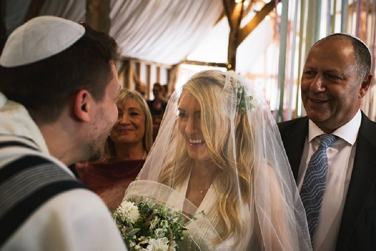 A fun festival Masorti Jewish wedding with a bride in an Alice Temperley dress at South Farm, Hertfordshire, UK | Smashing the Glass