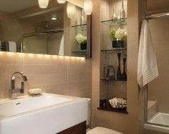 På hovedbadet kunne jeg tenke meg å ha innebygde hyller både i dusjen og over toalettet til toale...