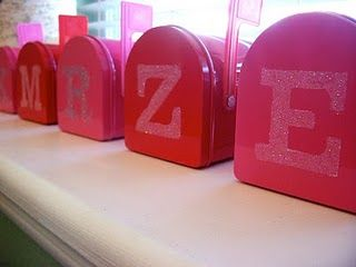 Mailboxes in the dollar section at Target.  Monogram stenciled in glitter.  Great for Valentines!
