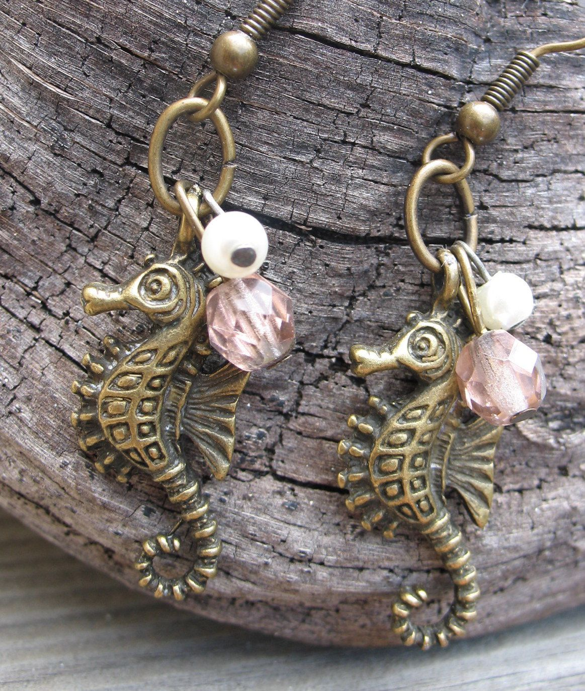 Sea Creature- Antiqued Gold Sea Horse Dangle Earrings with Firepolished Pale Pink Bead and Freshwater Pearl. $17.00, via Etsy.