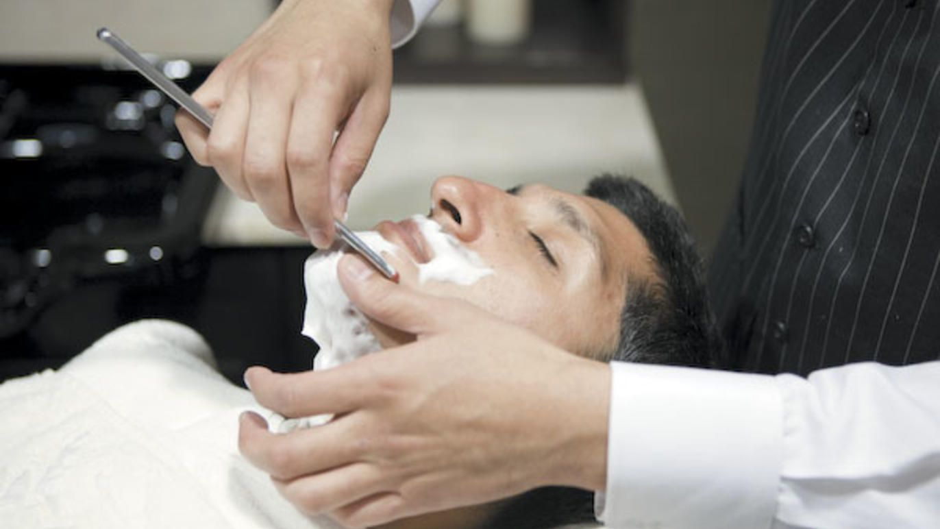 Take Dad for a clean shave at an old-fashioned barbershop or fancy spa.