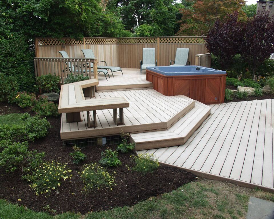Trex Deck With Hot Tub Here We Used Trex S Rope Swing Boards For The Deck And Designed Its Multi Levels Around The Cli Trex Deck Designs Building A Deck Patio