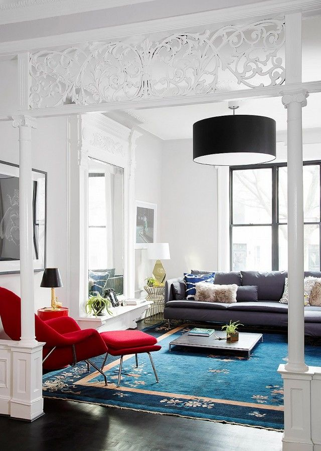 Living Room With A Large Area Rug Modern Black Light And Red Accent Chair
