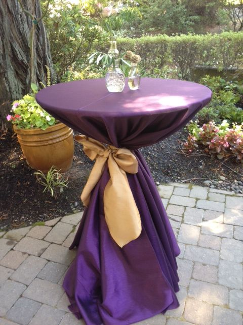 Cocktail Table With Eggplant Linens And Gold Sash Wine
