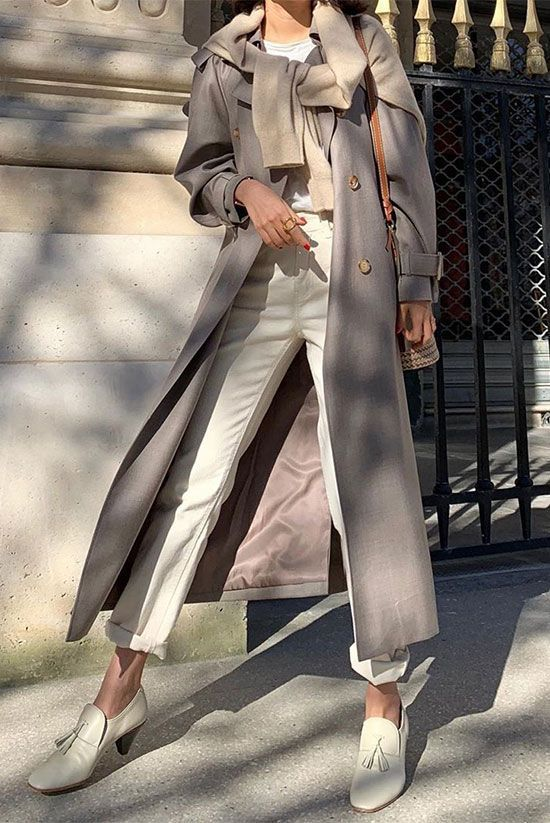 These Sweater Weather Trends Are A Must-Try This Year | Be Daze Live -  Fashion influencer @elborn_doris wearing a cream sweater over a grey trench coat, a white t-shirt,  - #90sFashionTrends #Daze #FashionTrendscasual #FashionTrendsover40 #FashionTrendsplussize #FashionTrendsspring #FashionTrendswork #Live #MustTry #Sweater #Trends #weather #Year