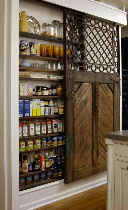 As we've seen before, sliding barn doors in the kitchen are great for entertaining and flow, but as these photos show they work just as well as a pantry door! Easy open, easy close, and space-saving, too. Do you have a sliding barn door in your kitchen? More photos below: