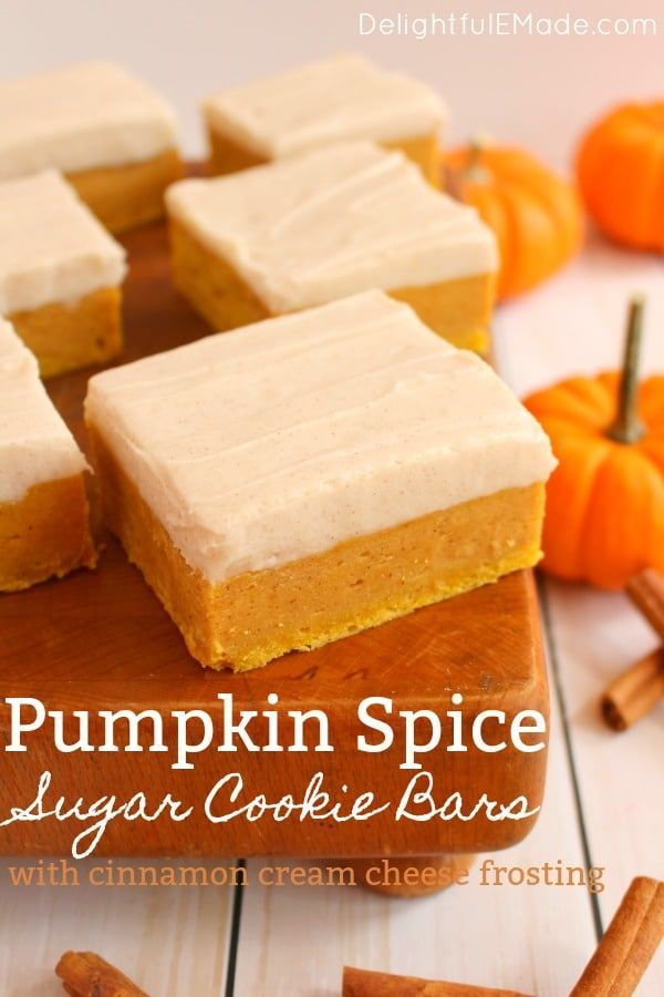 Pumpkin Spice Sugar Cookie Bars #cinnamonsugarcookies Sugar Cookie Bars with a delicious fall twist!  Cinnamon cream cheese frosting tops these wonderfully chewy, delicious pumpkin bar recipe.  Pairs perfectly with the fall favorite pumpkin spice latte! #cinnamonsugarcookies