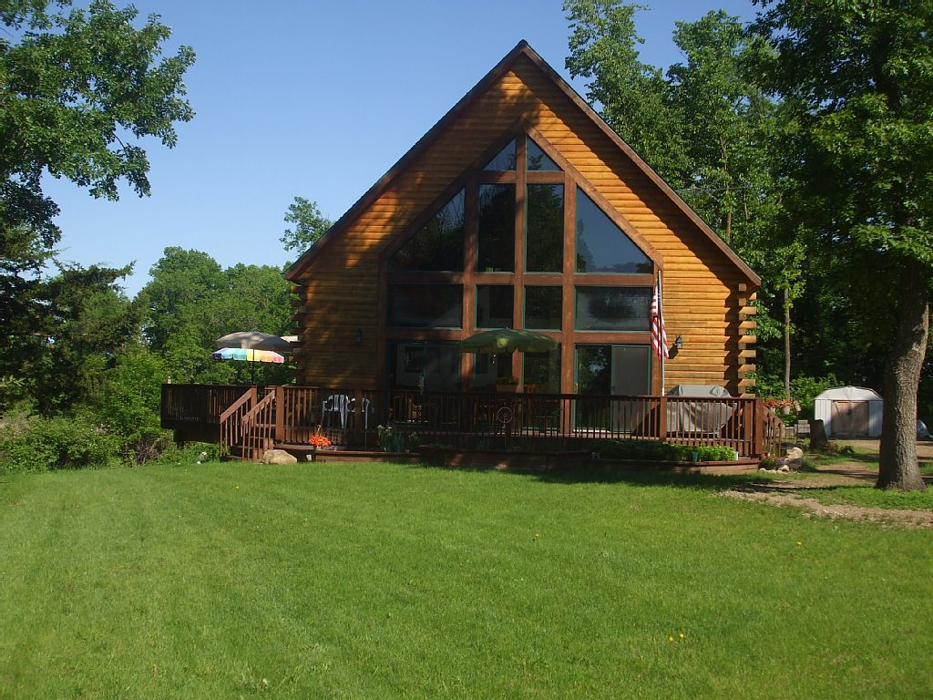 on click cabin den kitchen mn ely rentals resort gallery lakeside photo each cabins rent minnesota enlarge wolf for in to
