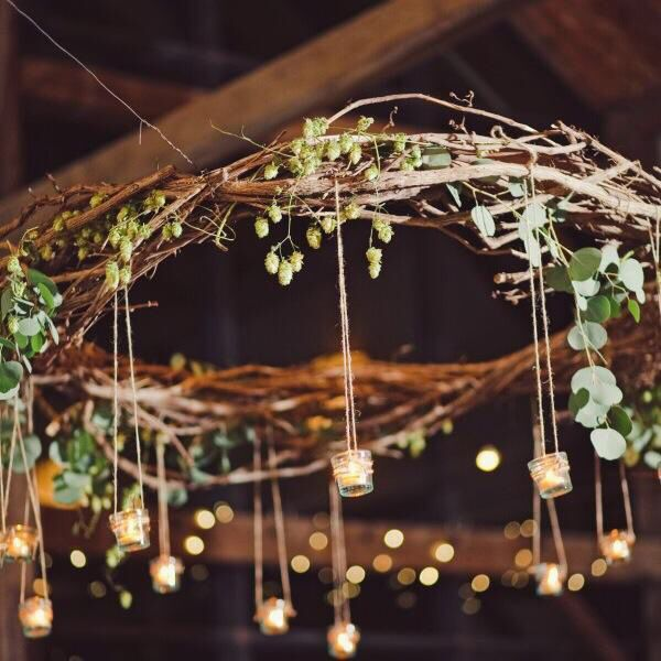 votive tea lights hanging from driftwood