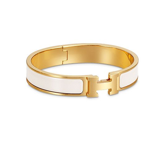 "Hermes narrow bracelet in enamel Gold plated hardware, 2.25"" diameter, 7.5"" circumference, 0.5"" wide."