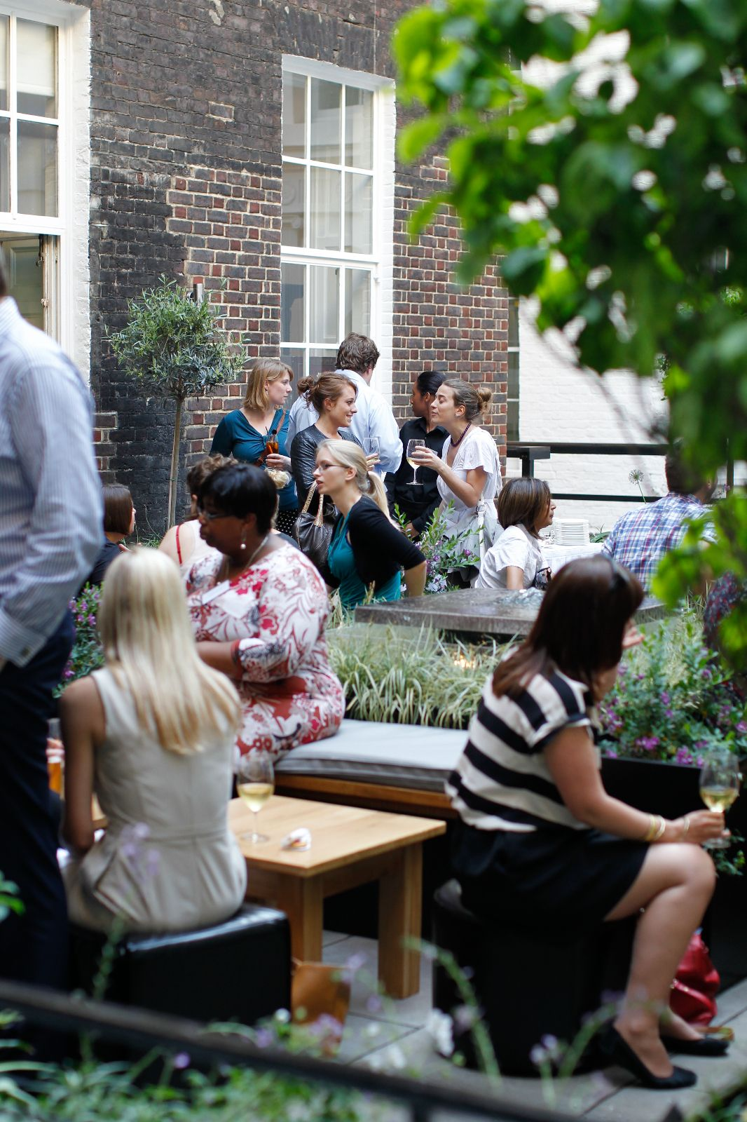Guests relaxing in our Garden Terrace during a summer drinks reception.