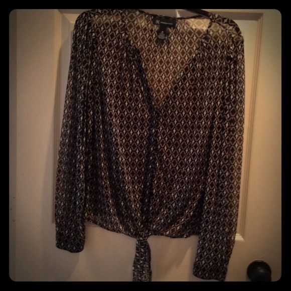 Cute sheer shirt Black , white and tan pattern sheer shirt never wore in perfect condition . Has tie in front INC International Concepts Dresses