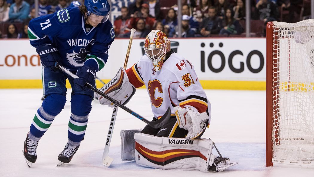Johnson Solid but Flames Fall to Canucks in Shootout