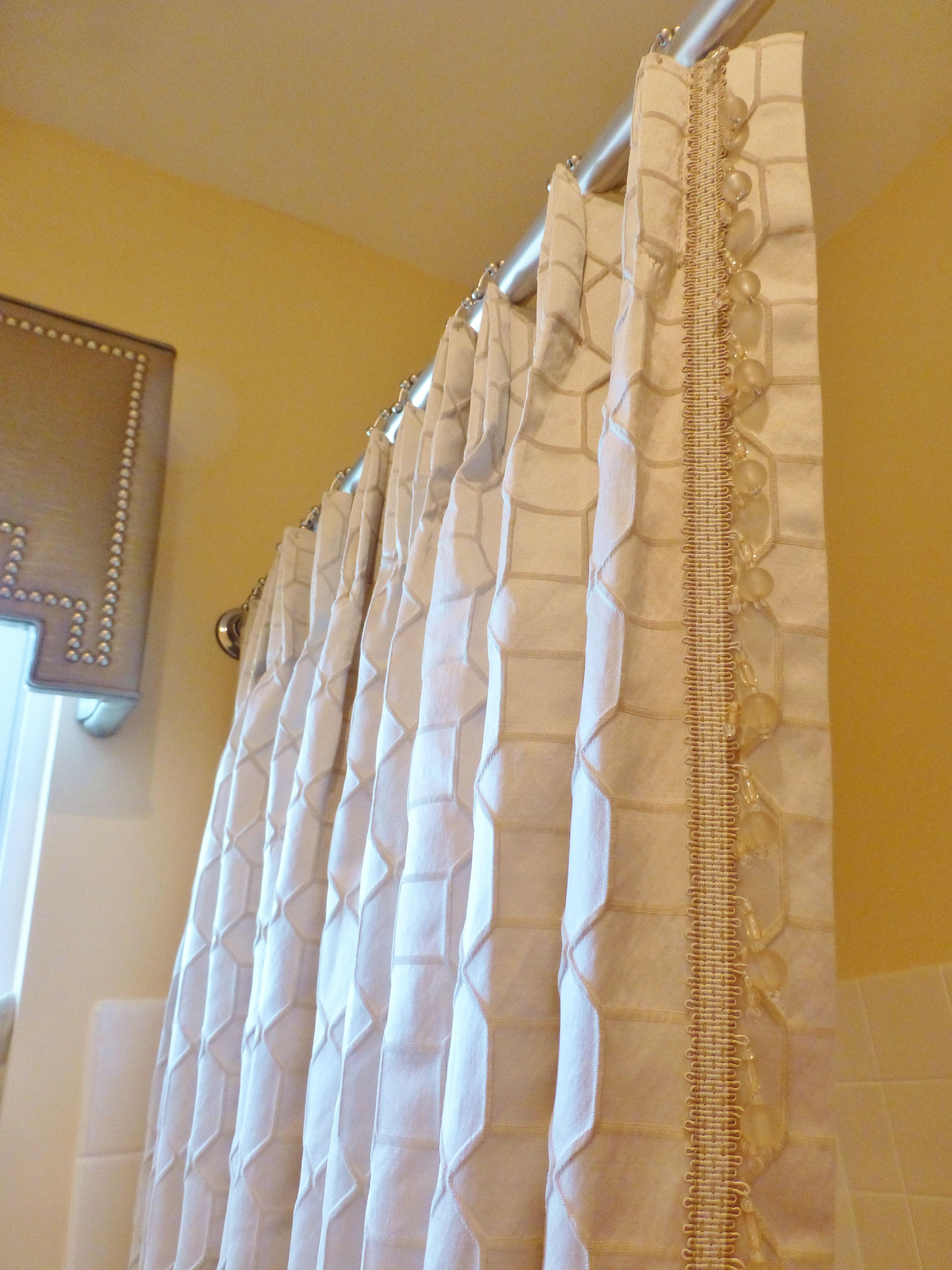 A Detail Of The Luxurious Custom Shower Curtain In This Neutral