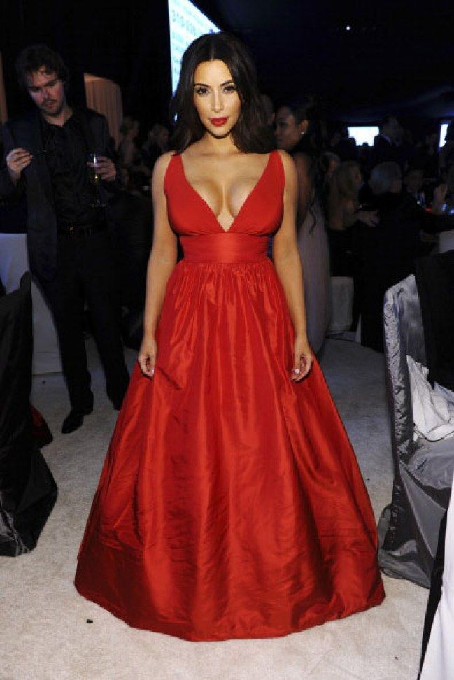 Kim Kardashian looks ravishing in this red satin gown, the colour looks amazing with her skin tone. We loved how she's teamed it with a statement red lip too. For more ideas click the picture or visit www.sofeminine.co.uk