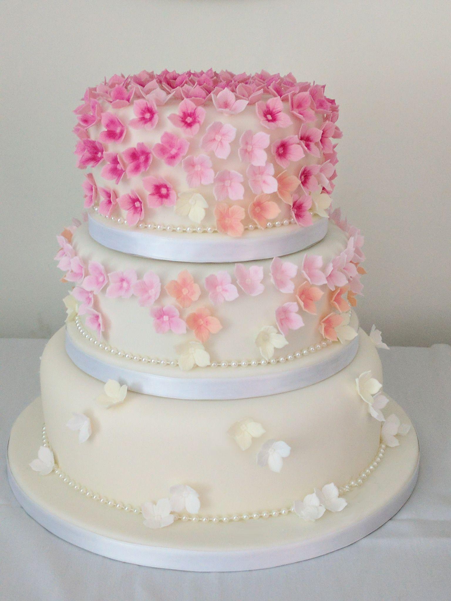 Three tiered wedding cake with ombré hydrangea flowers | wedcakes ...