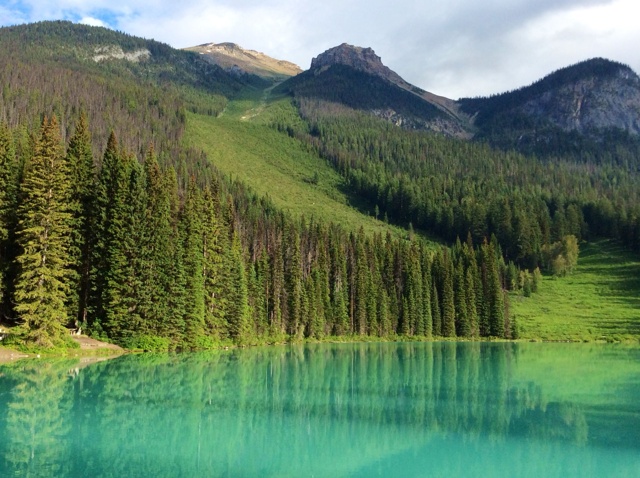 Beautiful Emerald Lake Near Alberta In Field BC. Gorgeous Setting With  Cabins, Lodge And