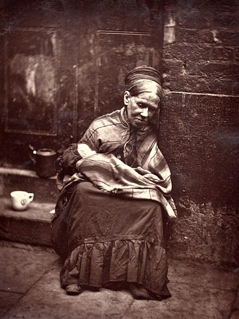 John Thomson  a Scottish Victorian photographer and traveler, whose work documenting the street people in London laid the foundation of social documentary and photojournalism.    This photo is called The Crawlers (cir. 1876 - 1877), a part of Thomson's work called Street Life of London, which documents in earnest the hardship of life of the transients and the poor in that era.