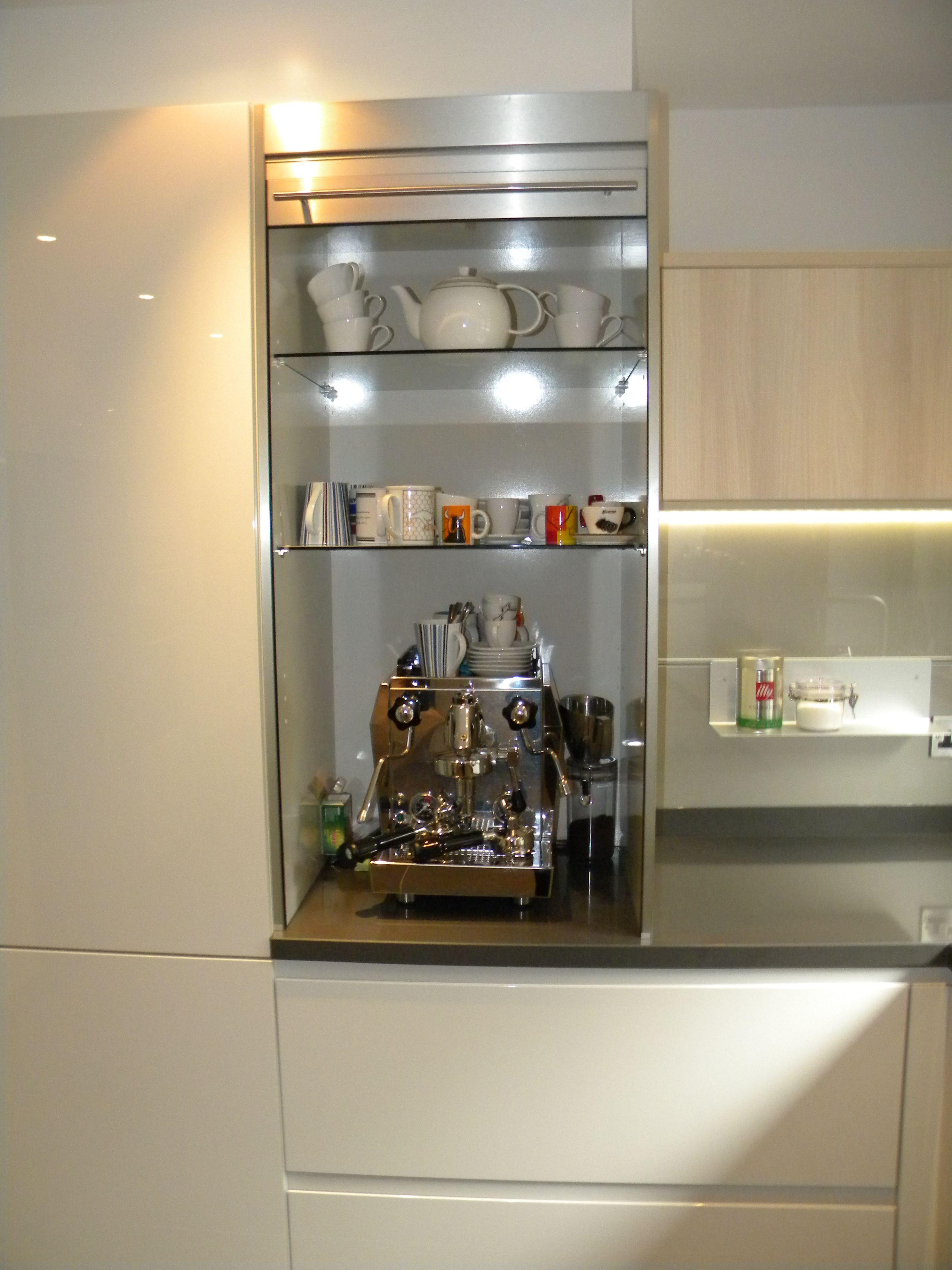 Stainless Steel Roller Shutter With Adjustable Glass Shelves Concealing Coffee Machine German Kitchen Glass Shelves Modern Kitchen