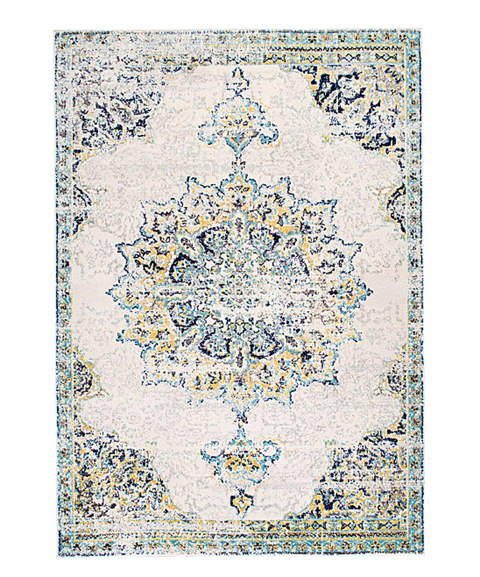Been drawn to the faded, aged looking rugs lately. But will I regret this in the long run? Blue Vintage Medallion Leola Rug by nuLOOM #zulilyfinds