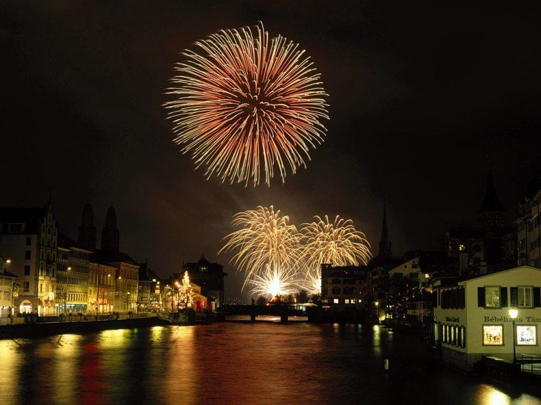 Some 200 000 Revelers Line The Banks Of The Limmat River And Lake Zurich To Watch Fi New Year S Eve Around The World Celebration Around The World New Years Eve