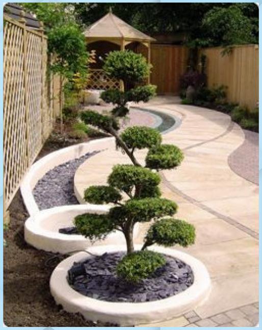 Photo of Curve, percorso e fioriere circolari utilizzate per la meditazione f – Giardino …