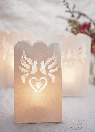 Romantically light the way for wedding guests at the ceremony or reception location with these Wedding Luminaries. Line a sidewalk, light an entry way or enhance a garden setting with these classic paper lanterns. For outdoor use only. Each package contains instructions. Candles sold separately. Luminaries are white and measure 10 inches tall.