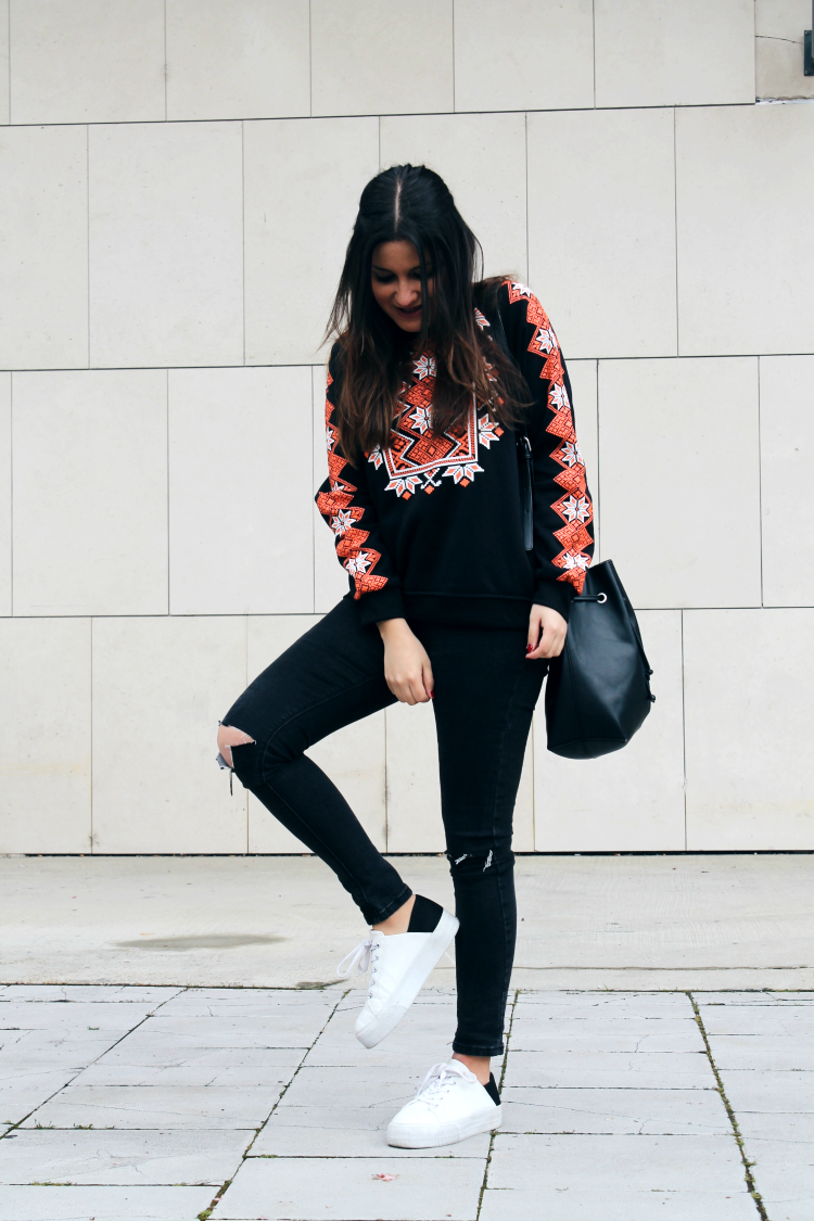 Comfy outfit wearing ethnic sweatshirt ripped jeans and sneakers