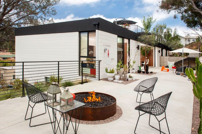Mid Century Inspired House With A Large Rooftop Deck Outdoor Fire Pit Seating Outdoor Fire Pit Outdoor Patio Designs