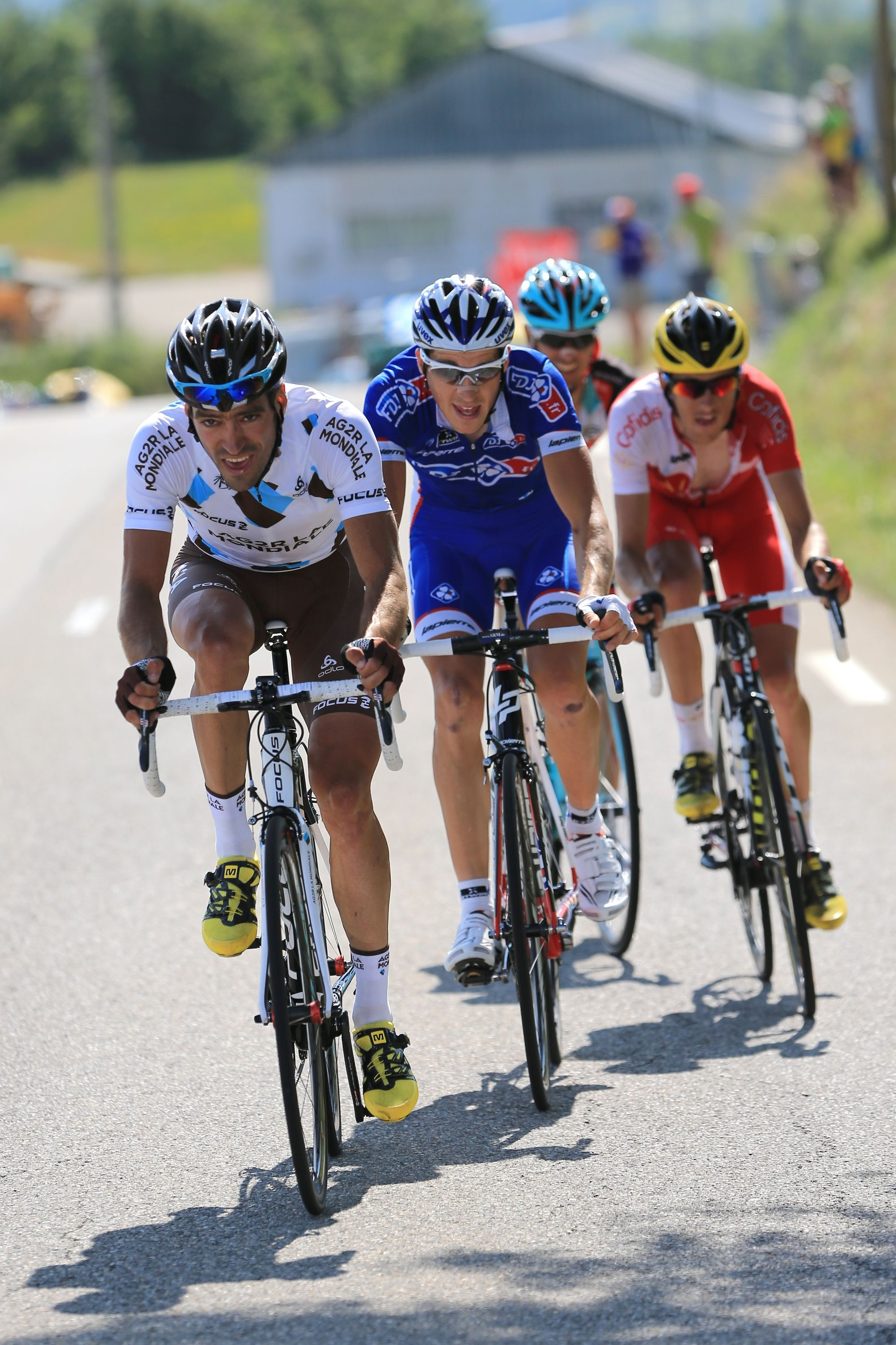 GAP, FRANCE - JULY 16: Arnold Jeannesson of France and Team FDJ.fr (2L) Andreas Kloden (back) of Germany and Team Radioshack Leopard, Jerome Coppel (R) of France and Team Cofidis Solutions Credits and Christophe Riblon (L) of France and Team AG2R La Mondiale in action during stage sixteen of the 2013 Tour de France, a 168KM road stage from Vaison-la-Romaine to Gap, on July 16, 2013 in Gap, France. (Photo by Doug Pensinger/Getty Images)