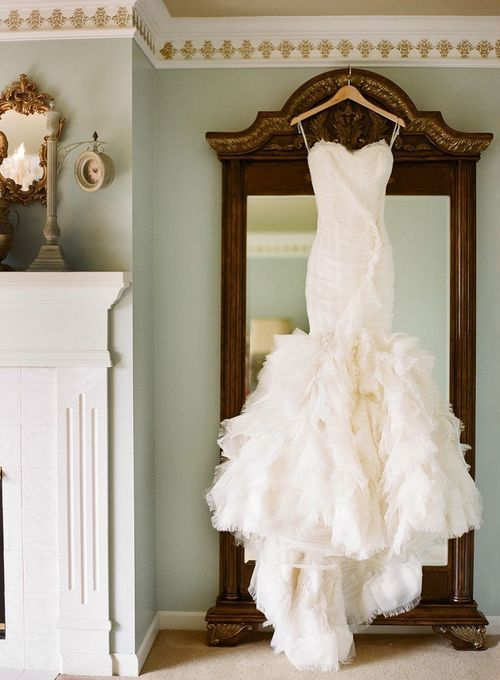 strapless mermaid style wedding gown with ruffle feather